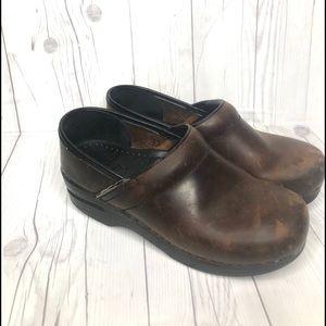 Dansko brown leather slip on professional clogs